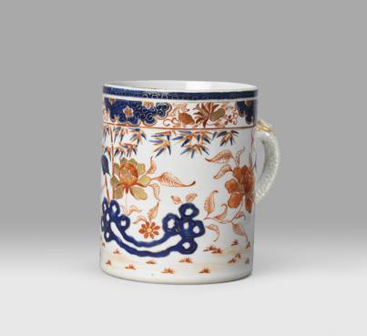 Mug decorated in overglaze blue, iron-red and sepia enamels and gold